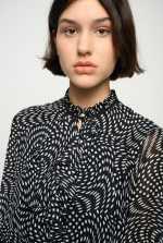 Asymmetric polka-dot short dress