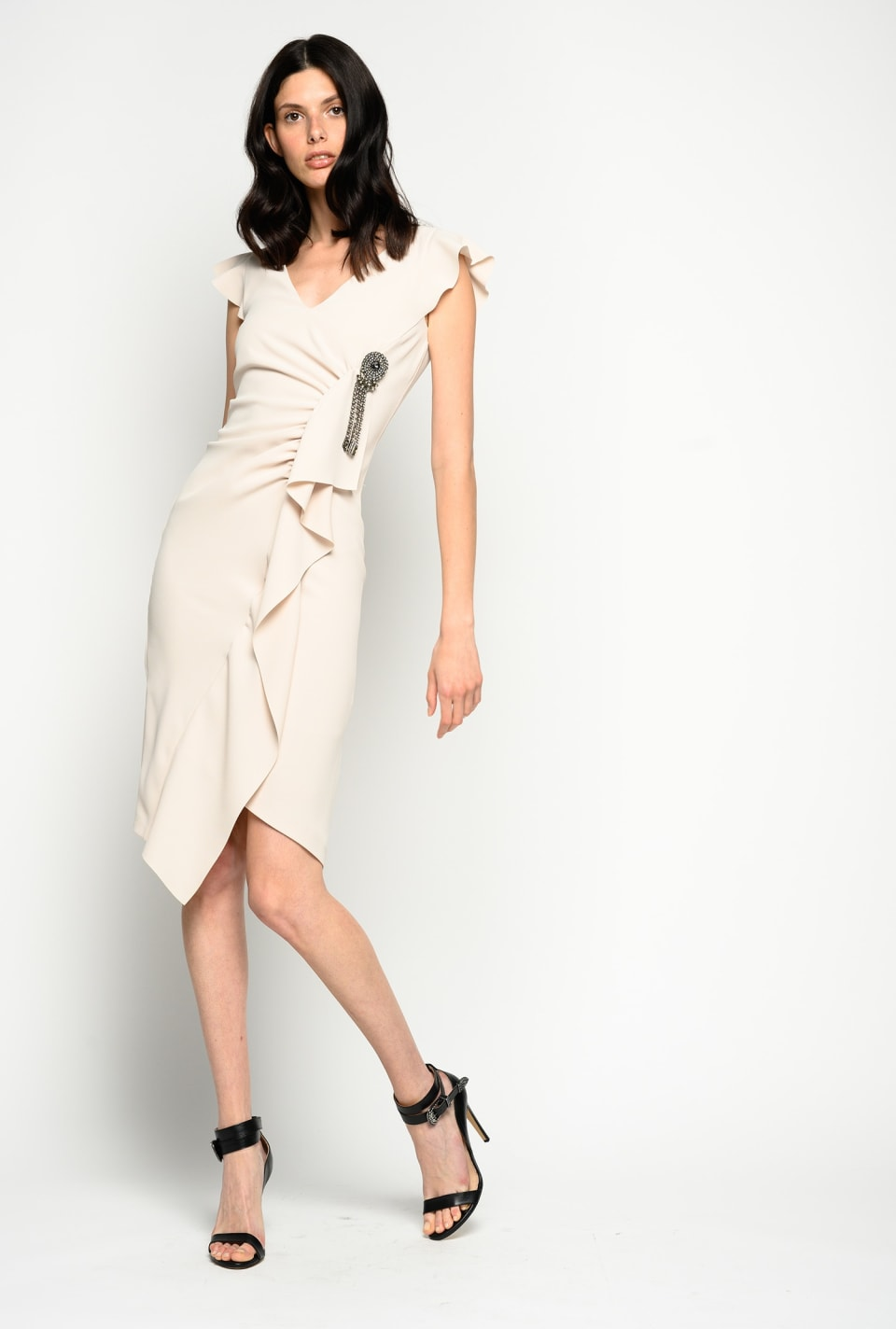 Midi dress with ruffle and brooch