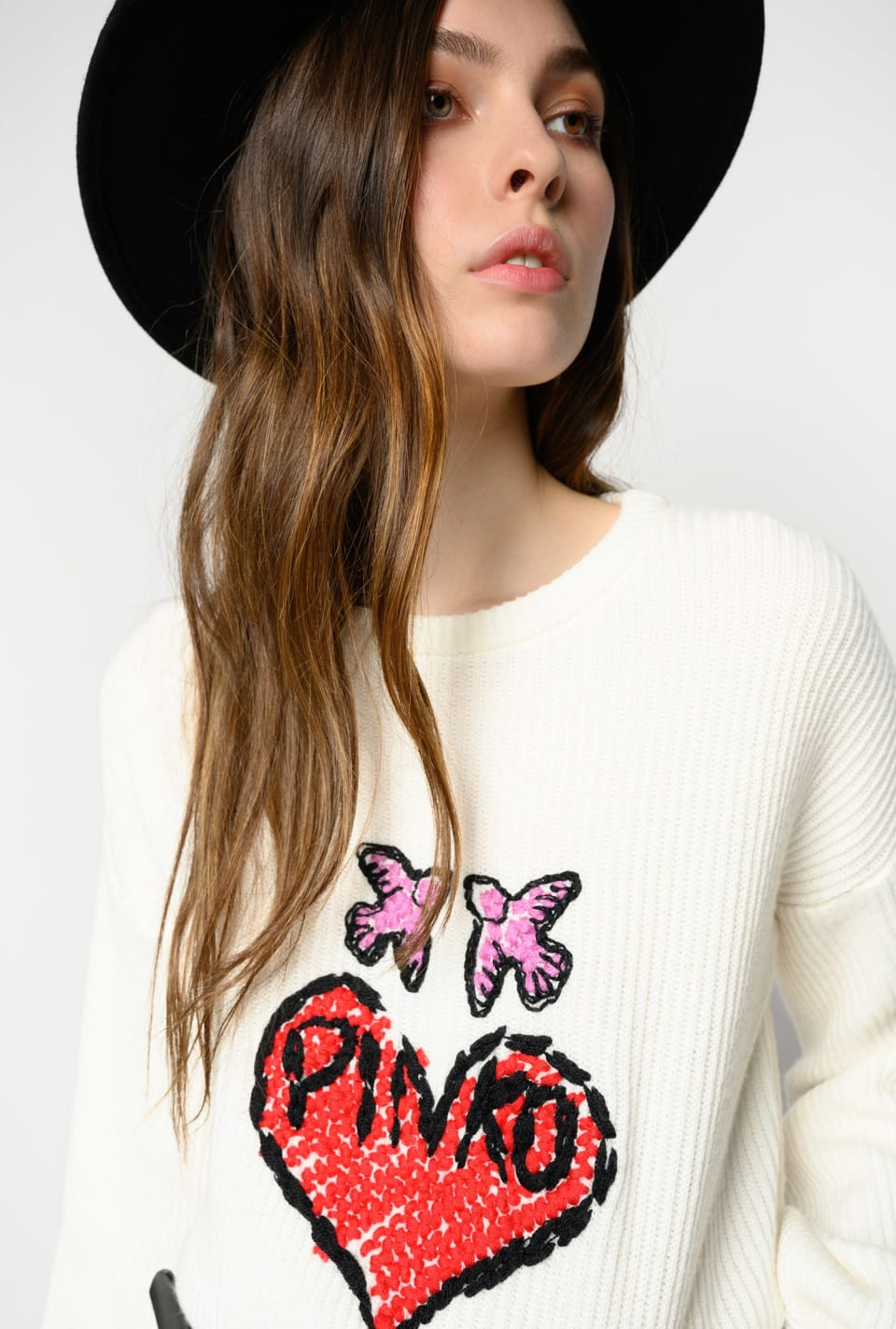 Pullover with embroidered heart