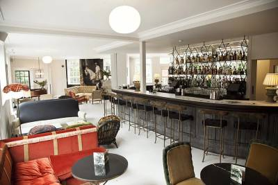 The bar is bright and airy, with an eclectic array of comfy seating