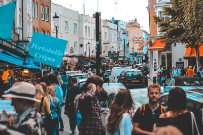 Cute stalls and boutiques along Portobello Road in Notting Hill