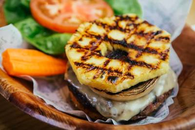 Hawaiian burger topped with cheese and grilled pineapple