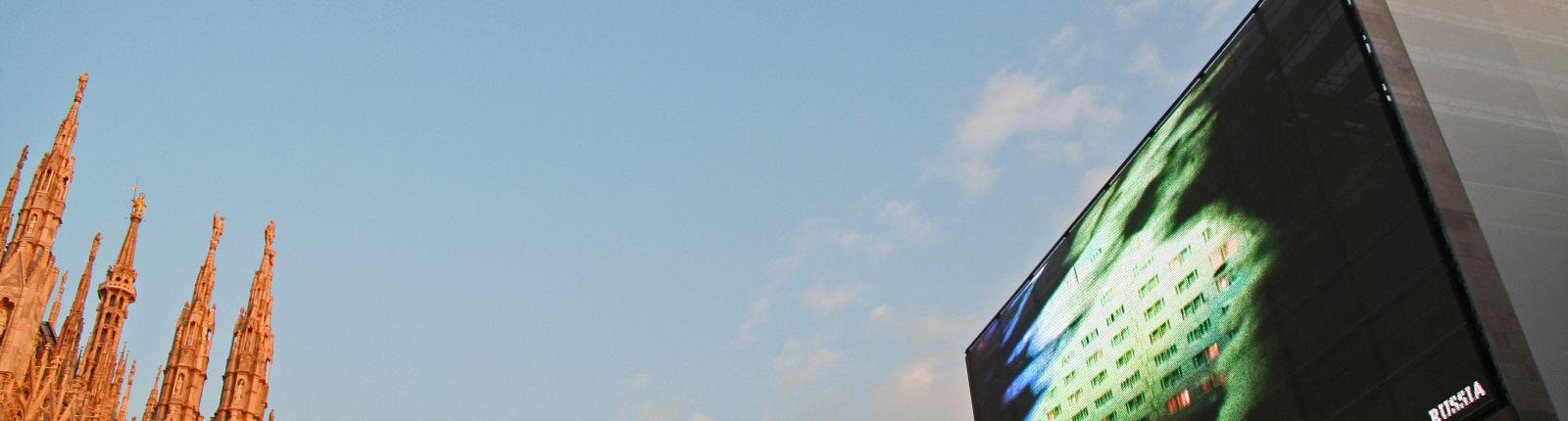 "Transparent media façade clads scaffolding at the ""Piazza del Duomo"" in Milan"