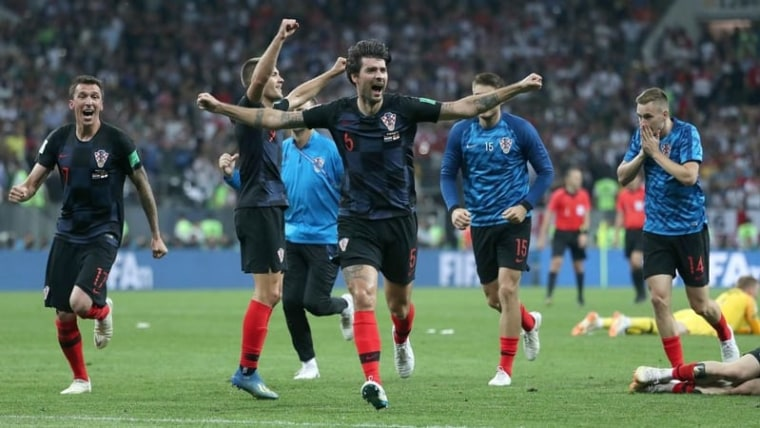 Vedran Čorluka celebrates with teammates after Croatia send England home (Igor Kralj/PIXSELL)