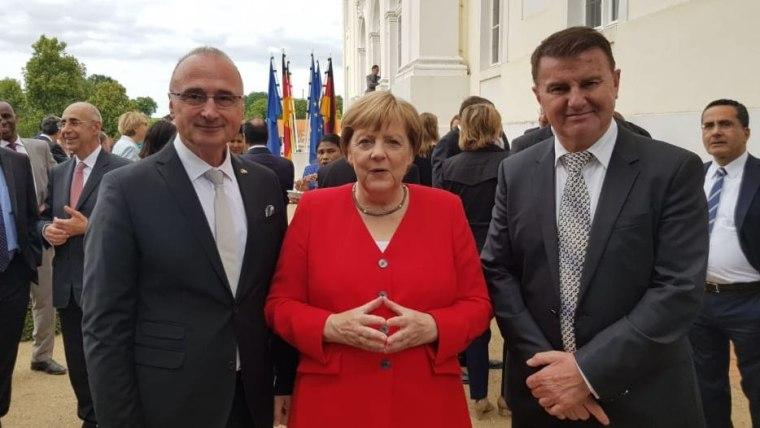 Grlić Radman, Merkel i But (Foto: screenshot/fenix-magazin.de)