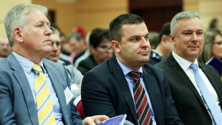 Žarko Katić (L) New HSLS Party Chairman Dario Hrebak (C) Outgoing party chairman Darinko Kosor (R) (Photo: Emica Elvedji/PIXSELL)