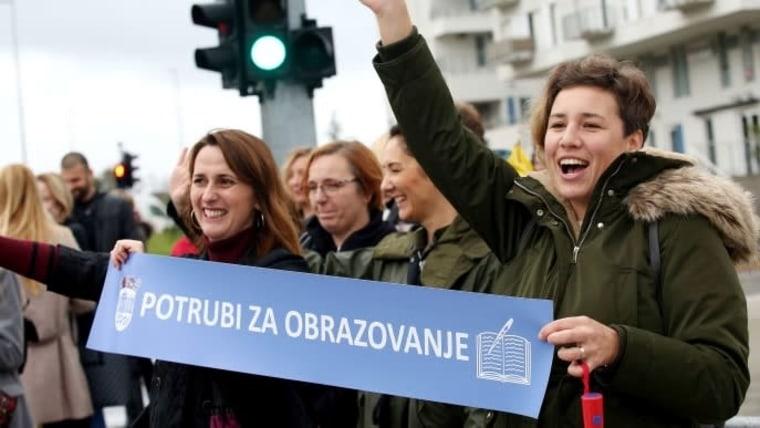 "Striking teachers holding a banner reading ""Honk for Education.""  (Photo: Dusko Jaramaz/PIXSELL)"