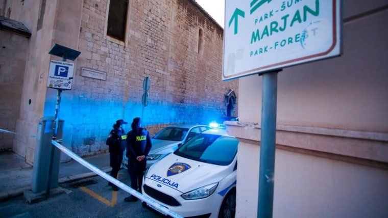 Police guard the the location where one of the victims was shot on Saturday (Milan Sabic/PIXSELL)