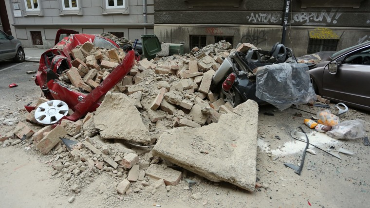 Car destroyed during Sunday's earthquake (Photo: Emica Elvedji/PIXSELL)