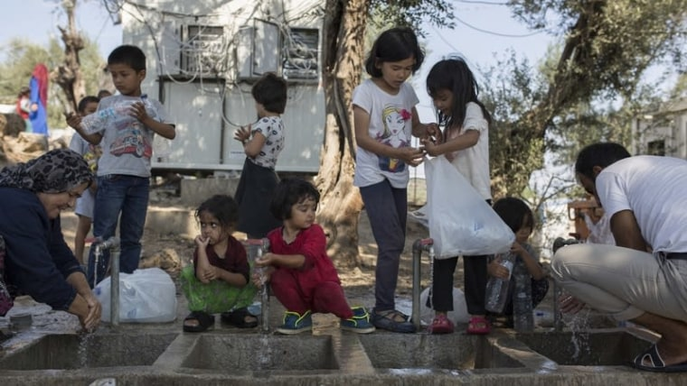 A 2018 file photo of children washing at camp Moira in Greece (Socrates Baltagiannis/DPA/PIXSELL)