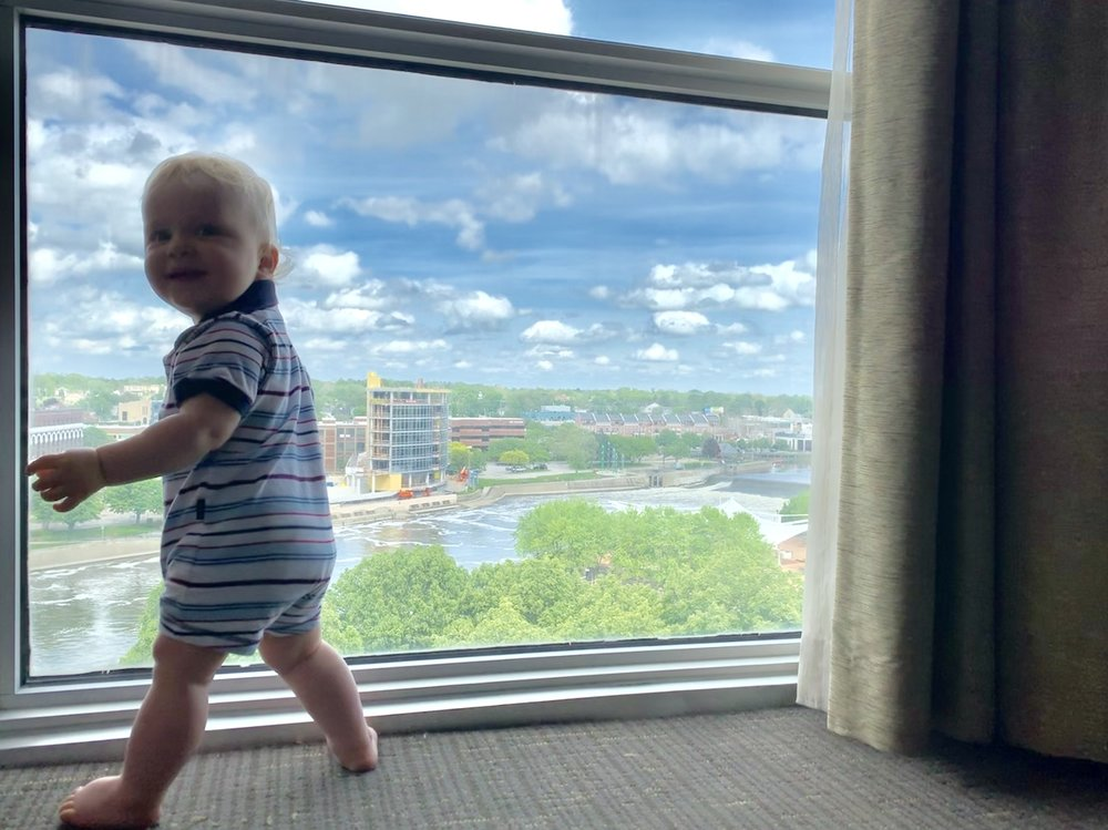 Bjorn at hotel window, looking very excited