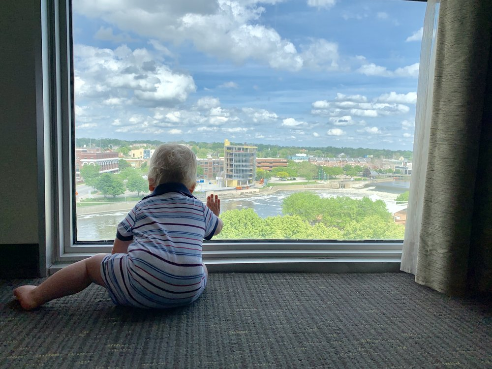 Bjorn at hotel window, sitting and gazing out