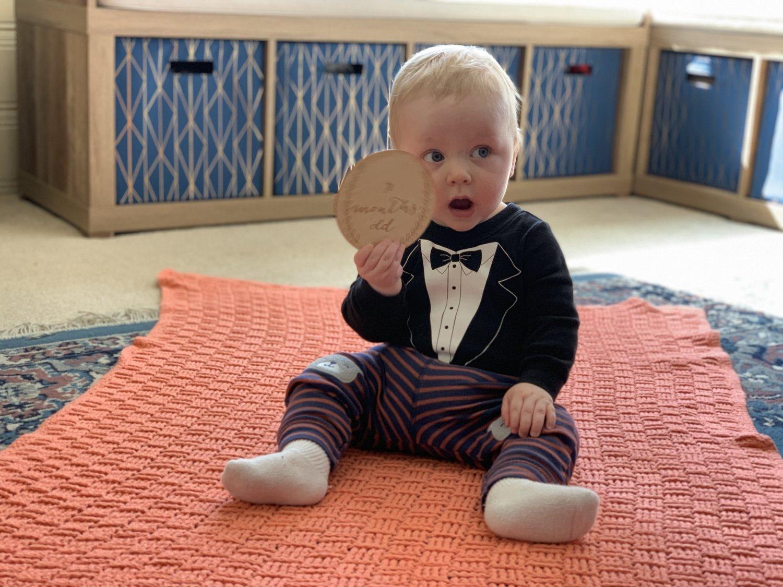 Bjorn holding 10 months card