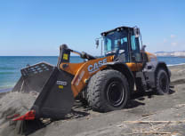 The wheel loader sifted the beach's black sand with a three-cubic metre skeleton bucket (Case)