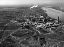 Nuclear reactors line the Clombia River at the Hanford Site, Washington State, in January 1960. The historic B Reactor, the world's first plutonium production reactor, is visible in the distance (US Department of Energy/Public domain)