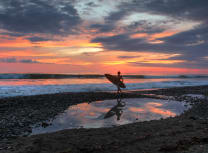 A surfer at Playa Dominical in Costa Rica (Dreamstime)