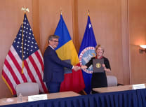 Romanian energy minister Virgil Popescu shaking on the October agreement with Kimberly  Reed, president of the US Export-Import Bank (Nuclearelectrica)