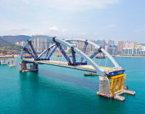 Hong Kong first: 10,000-tonne double-arch steel bridge floated and sunk into place