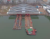 Gently does it: See how Mammoet barged ahead to get a very heavy bridge over the Danube