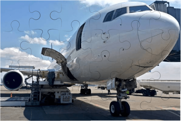 Assembled puzzle with a picture of an airplane loading cargo