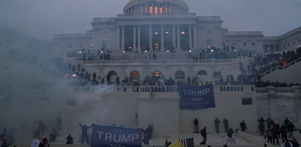 תומכי טראמפ מסתערים על הקפיטול / צילום: Reuters, Leah Millis