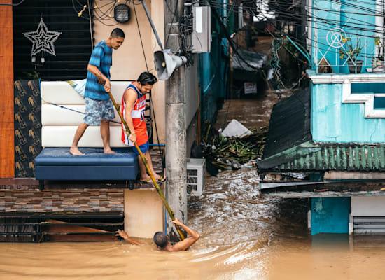 הצפות בפיליפינים / צילום: Jilson Tiu