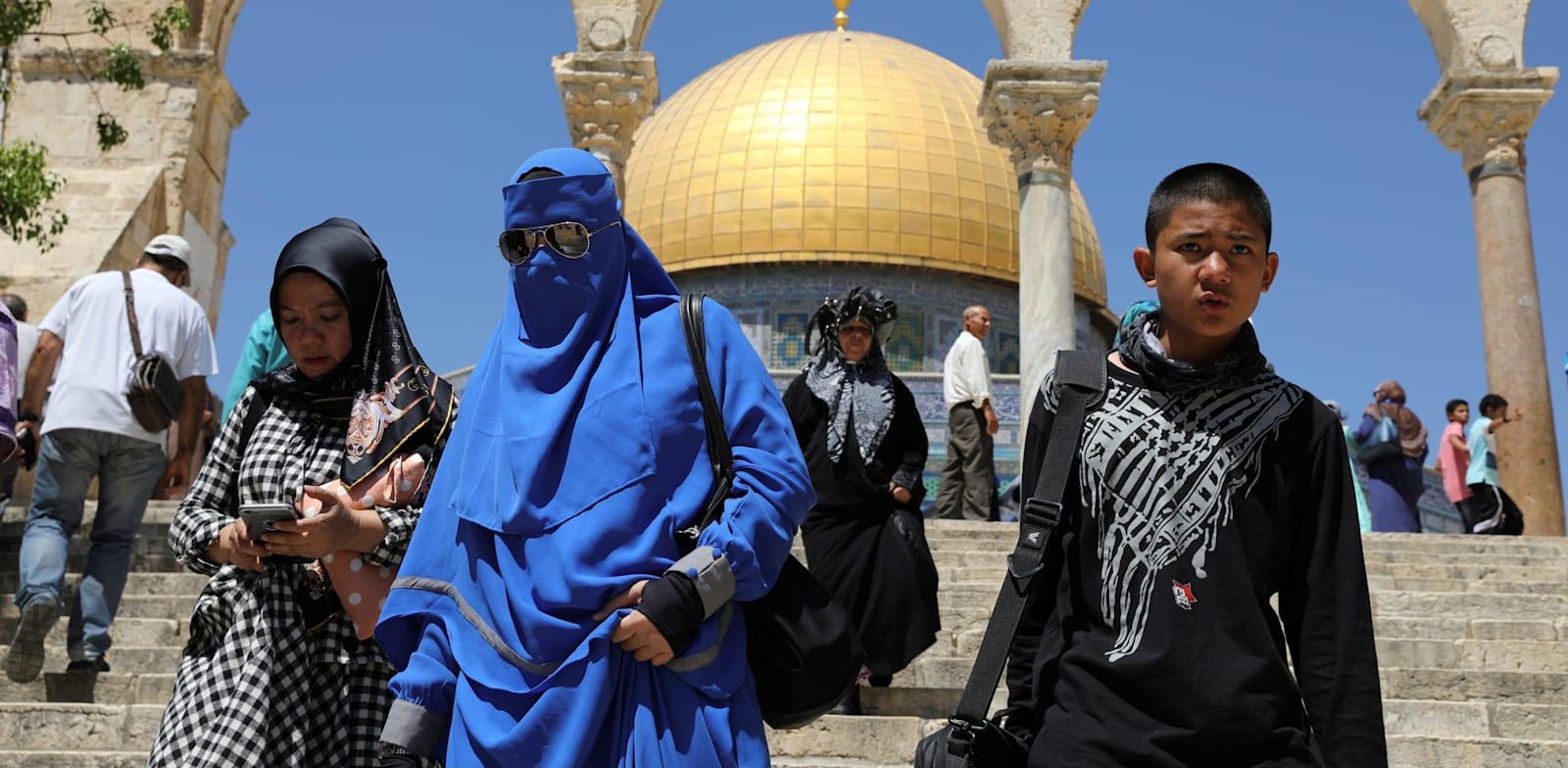 תיירים מוסלמים בירושלים / צילום: Reuters, AMMAR AWAD