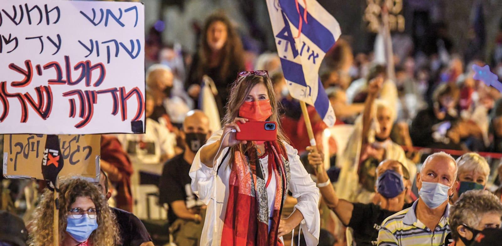 """אור-לי ברלב בהפגנה ליד רחוב בלפור בירושלים. """"מעולם לא הייתי מעורבת באף מפלגה"""" / צילום: בן כהן"""