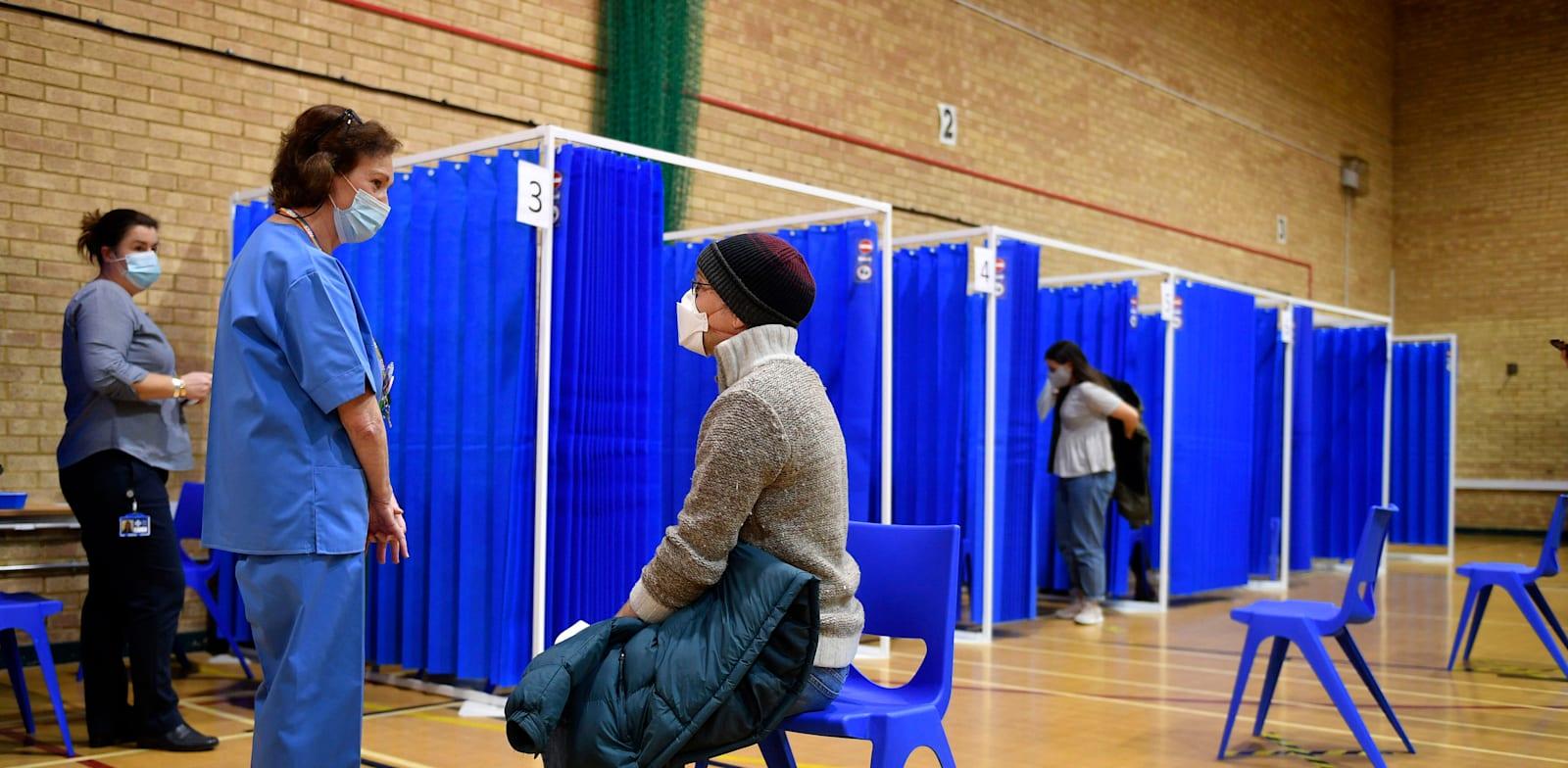 מבצע החיסונים לקורונה בבריטניה / צילום: Associated Press