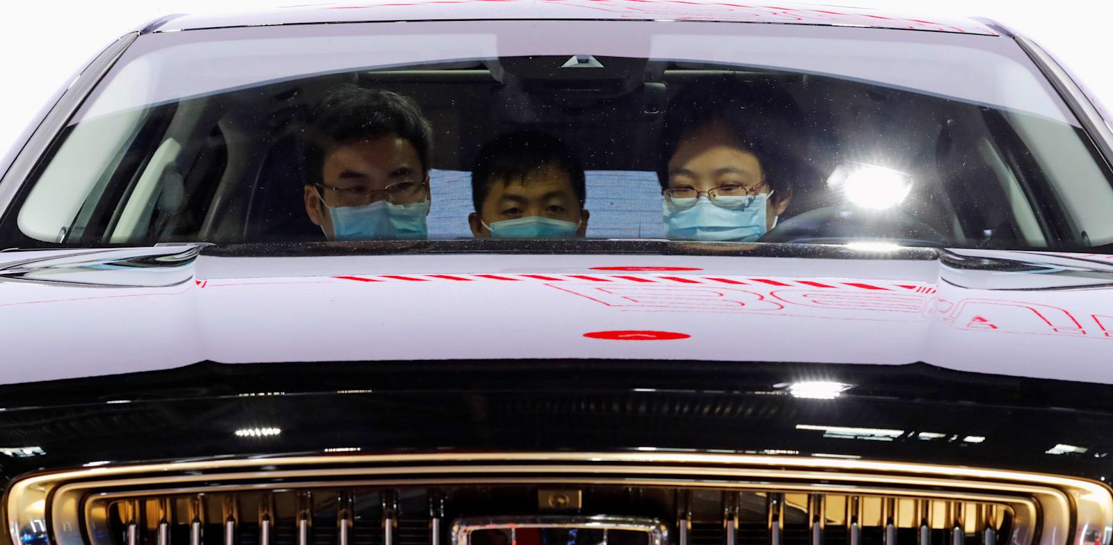 מכונית של ג'ילי בתערוכת הרכב בבייג'ינג, בספטמבר. כפי שנחשף בגלובס, יוניון תייבא את המותג / צילום: Reuters, THOMAS PETER