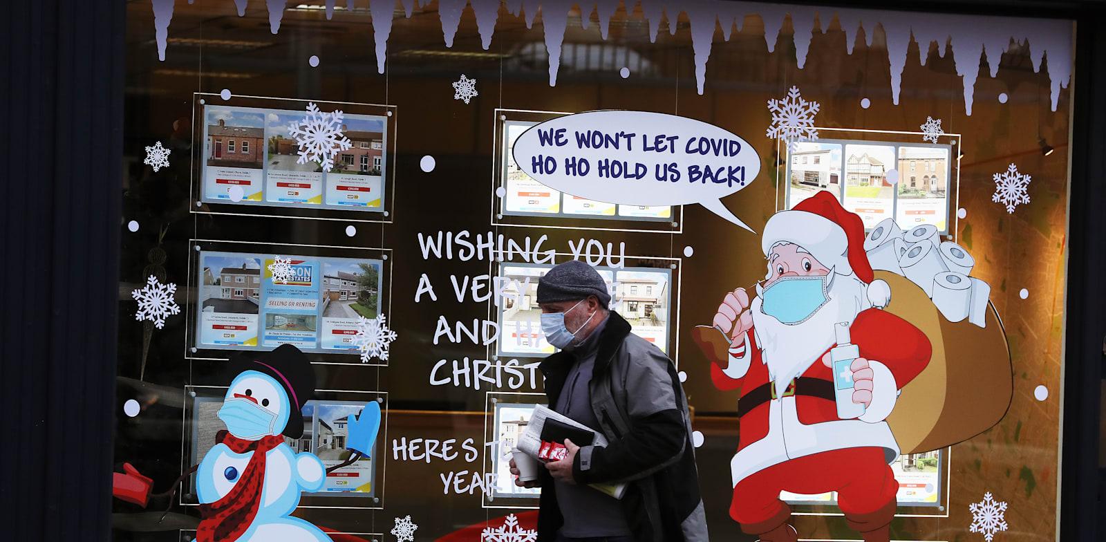 """סוכנות נדל""""ן בדבלין, אירלנד. האופן שבו משולמת המשכנתה, משפיע באופן ישיר על מקבלי ההחלטות במדינה / צילום: Reuters, Brian Lawless"""
