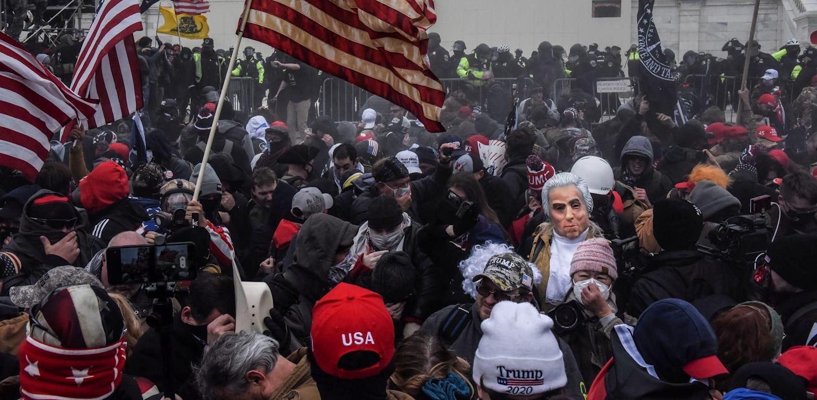 המהומות בבניין הקפיטול, בשבוע שעבר / צילום: Reuters, STEPHANIE KEITH