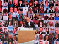 ארמין לאשט שנבחר לראש להנהגת המפלגה הנוצרית-דמוקרטית הגרמנית. מאחוריו בזום מופיעים הנציגים שהצביעו לו / צילום: Associated Press, Markus Schreiber