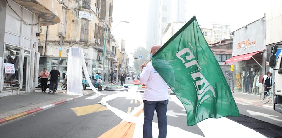"""הפגנה של עסקים קטנים בדרך יפו בת""""א על המצב הכלכלי הקשה / צילום: כדיה לוי"""