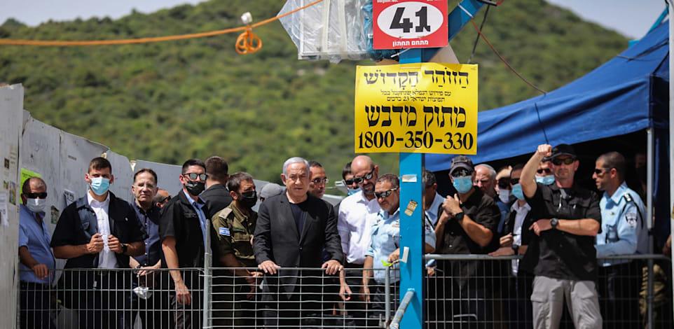 ראש הממשלה נתניהו בזירת האסון / צילום: Reuters, Ilia Yefimovich/dpa