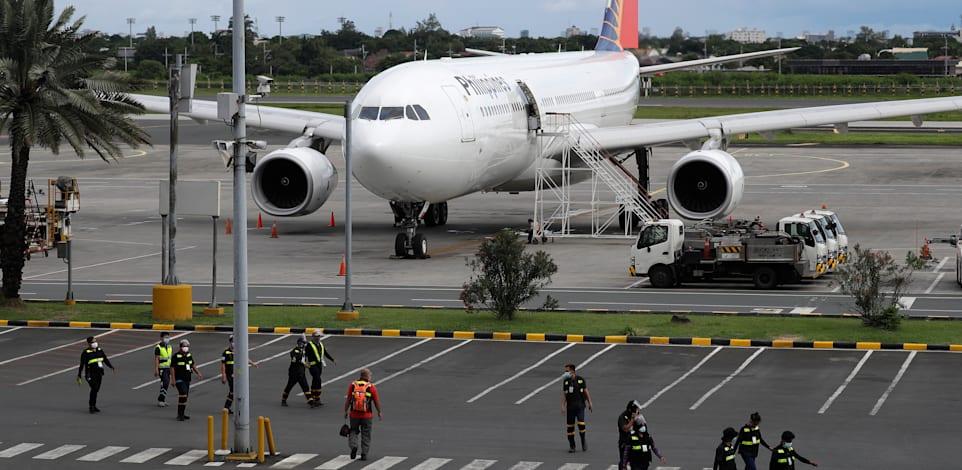 שדה התעופה במנילה. האם נראה עד סוף השנה טיסות ישירות? / צילום: Associated Press, Aaron Favila