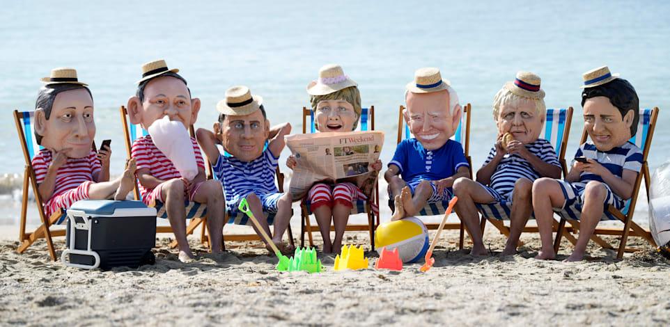מחאה נגד יחס מדינות ה־G7 לבעיות האקלים בשולי הפסגה ביום שבת בפלימות', בריטניה / צילום: Associated Press, Alastair Gran