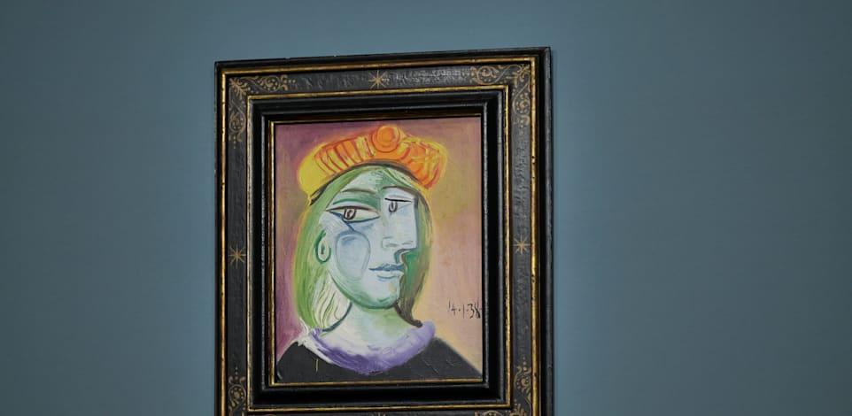 ''אישה עם כובע כתום'' של פיקאסו. נמכר עבור יותר מ-40 מיליון דולר / צילום: Reuters, ברידג'יט בנט