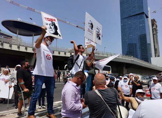 """מחאת נכי צה""""ל / צילום: איל יצהר"""