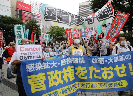 הפגנה נגד קיום האולימפיארד ונגד הממשלה בטוקיו, השבוע / צילום: Reuters, Yoshio Tsunoda