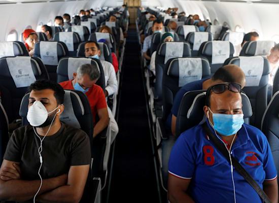 טיסה בזמני קורונה / צילום: Reuters, Mohamed Abd El Ghany