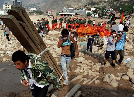 השיטפונות בסין פגעו במיליונים: מחוז גאנסו שבצפון מערב סין / צילום: Associated Press, Ng Han Guan