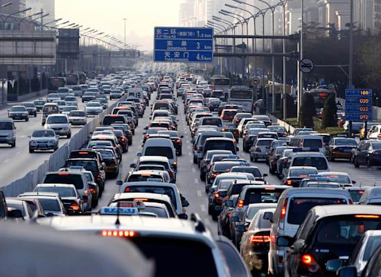 סין. הפחתת זיהום אוויר מכלי רכב / צילום: Associated Press, Larry Downing