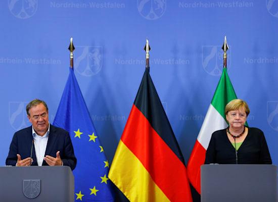 אנגלה מרקל וארמין לאשט / צילום: Reuters, THILO SCHMUELGEN