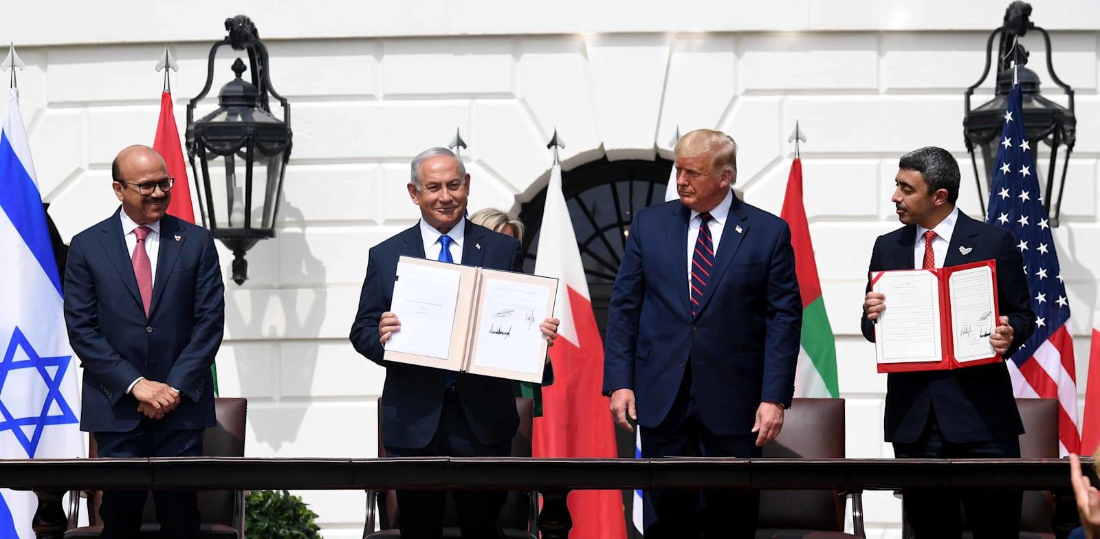 נתניהו, טראמפ, בן ראשיד ובן זאיד בטקס החתימה על הסכמי אברהם. ספטמבר 2020 / צילום: אבי אוחיון, לע''מ