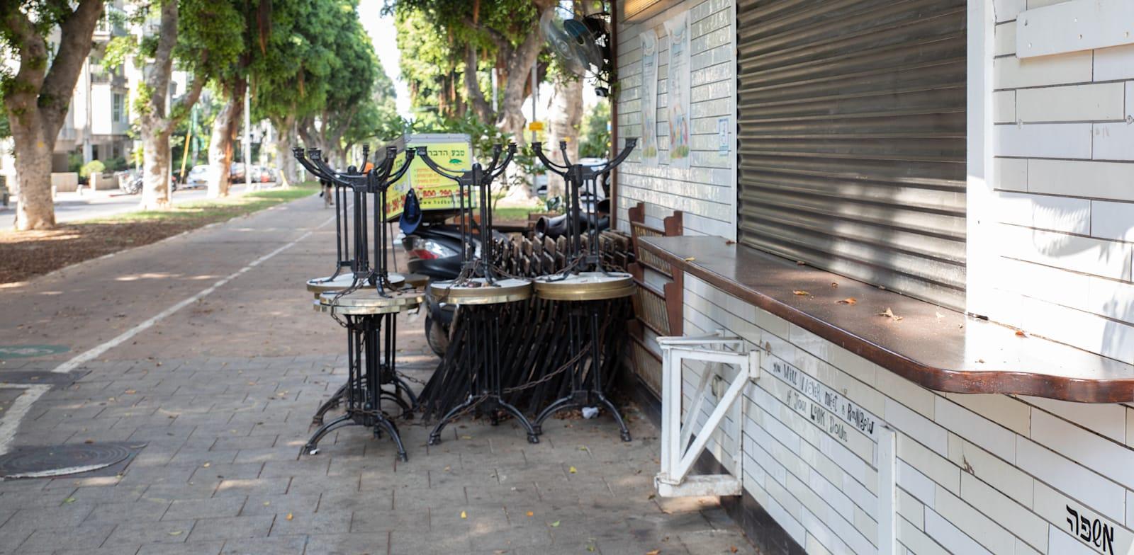 """עסק סגור בת""""א. אף עסק עוד לא נהנה מהתנאים המקלים שאושרו / צילום: כדיה לוי"""
