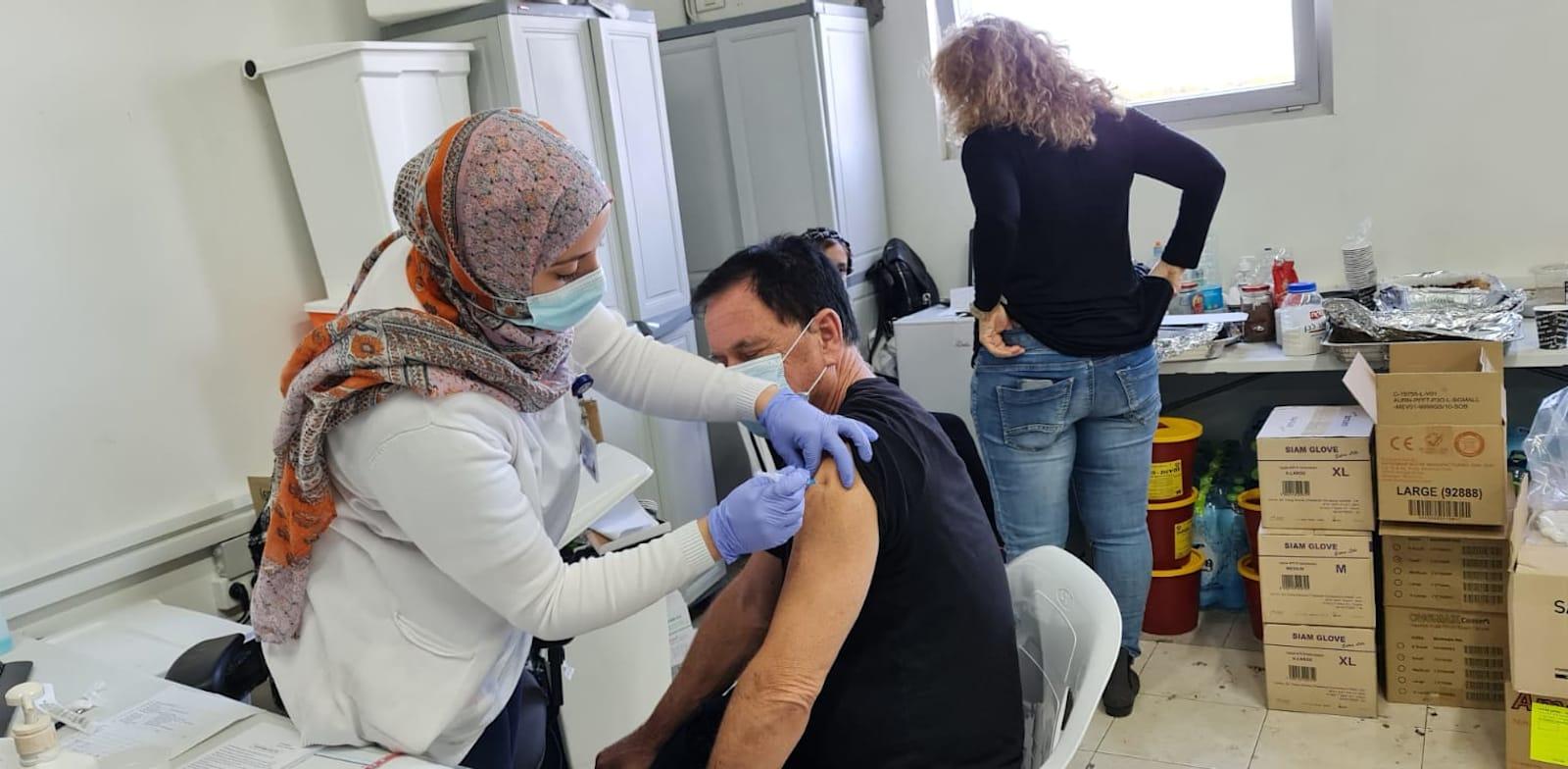 Vaccination in Petah Tikva Credit: Bar-El