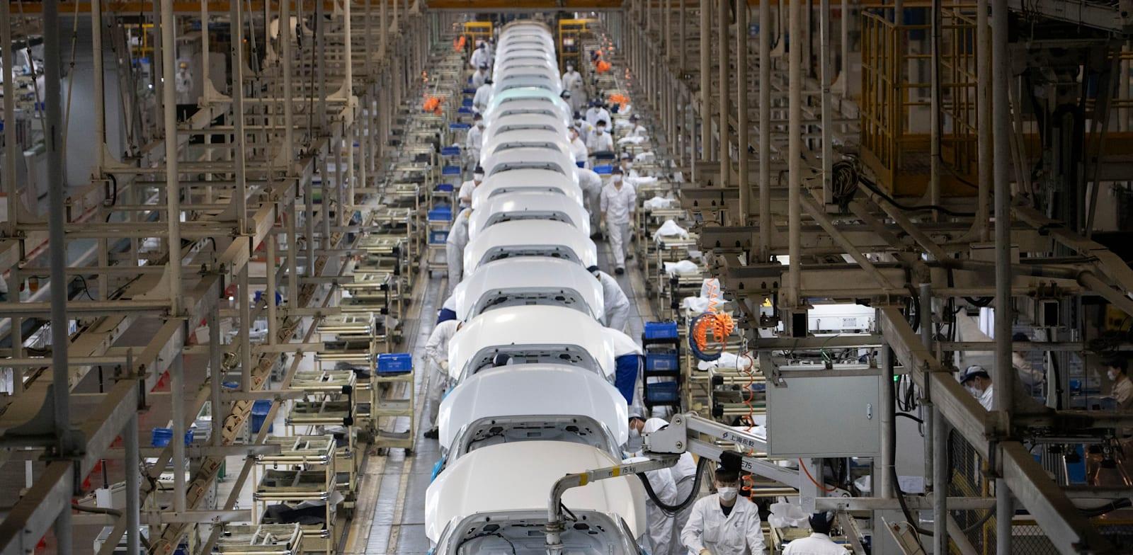 מפעל מכוניות בסין / צילום: Associated Press, Ng Han Guan