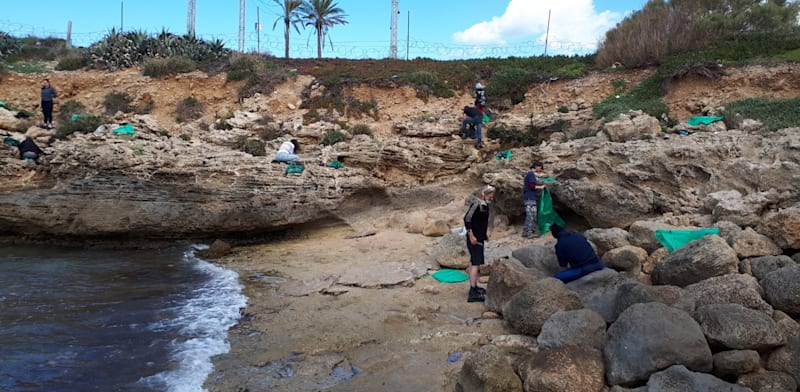 Volunteers cleaning beaches  credit: Sharon and Carmel Cities Association