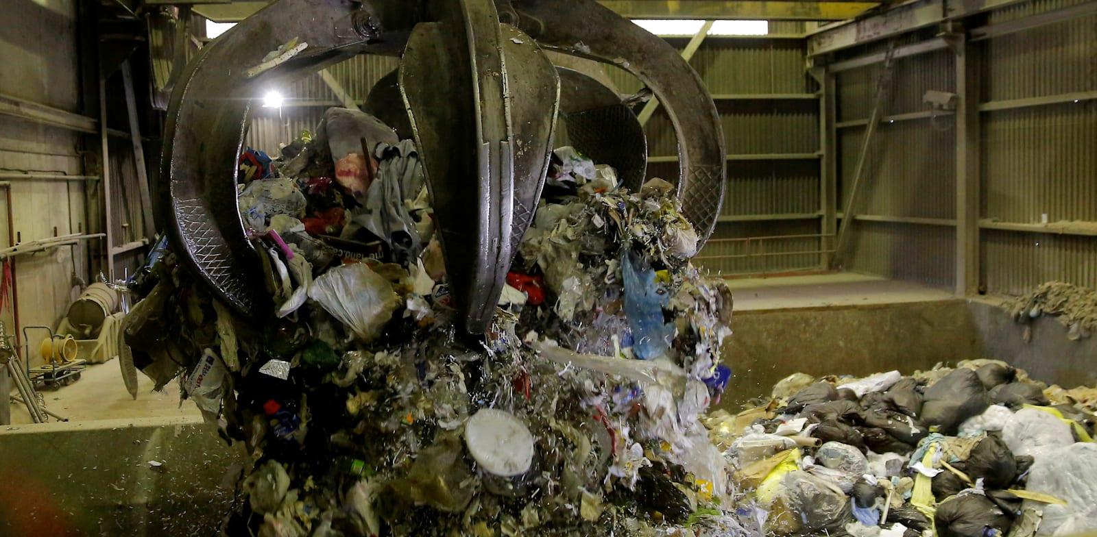פסולת במתקן שרפה בקנדה / צילום: Reuters, Lindsey Wasson
